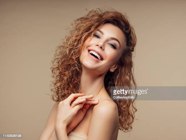 brown haired woman with voluminous hairstyle - frizzy stock pictures, royalty-free photos & images