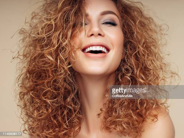 brown haired woman with voluminous hairstyle - wavy hair stock pictures, royalty-free photos & images