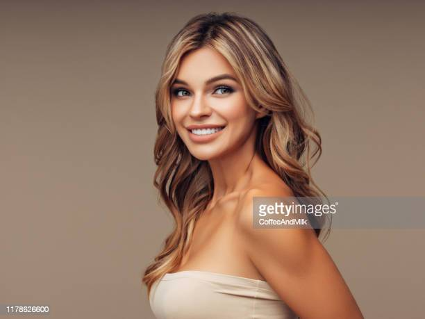 brown haired woman with voluminous hairstyle - beautiful woman face stock pictures, royalty-free photos & images