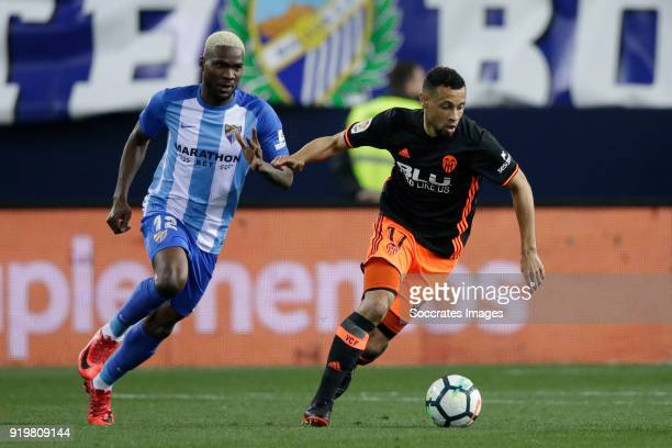 Brown Ideye of Malaga CF Francis Coquelin of Valencia CF during the La Liga Santander match between Malaga v Valencia at the Estadio La Rosaleda on...