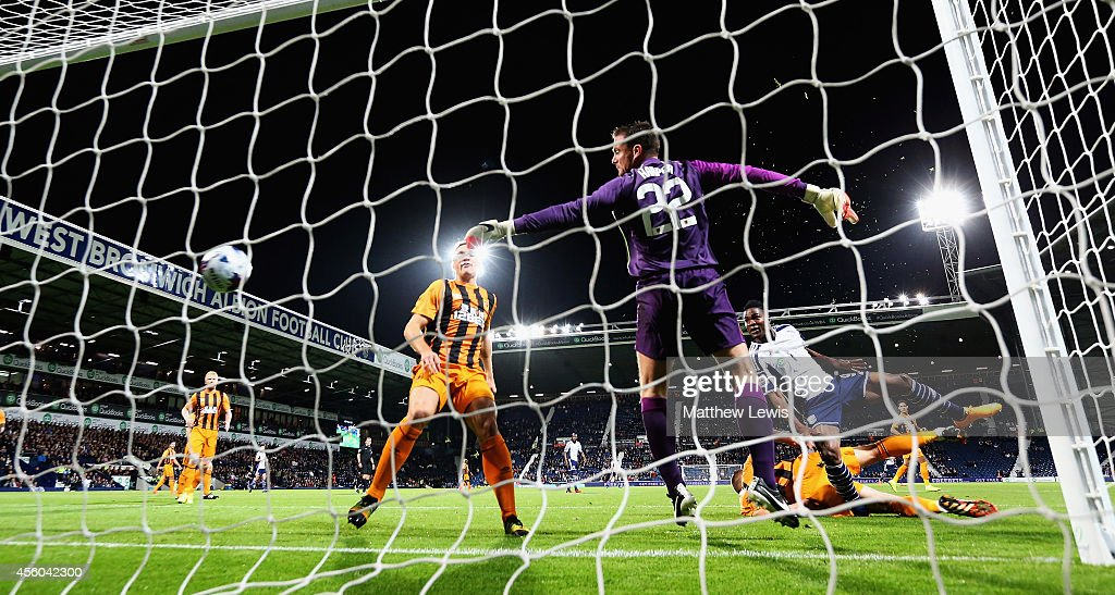 Brown Ideye of West Bromwich Albion beats Steve Harper of Hull City to score a goal during the Capital One Cup Third Round match between West Bromwich Albion and Hull City at The Hawthorns on September 24, 2014 in West Bromwich, England.