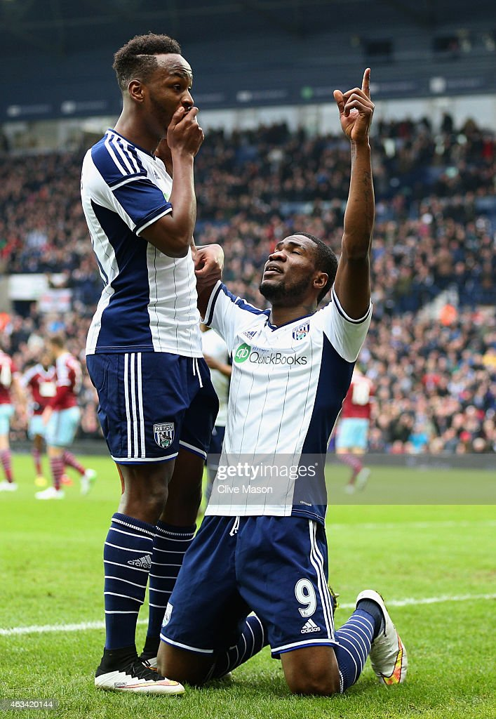 Brown Ideye of West Bromwich Albion (9) celebrates with team mate Saido Berahino (L) as he scores their first goal during the FA Cup Fifth Round match between West Bromwich Albion and West Ham United at The Hawthorns on February 14, 2015 in West Bromwich, England.