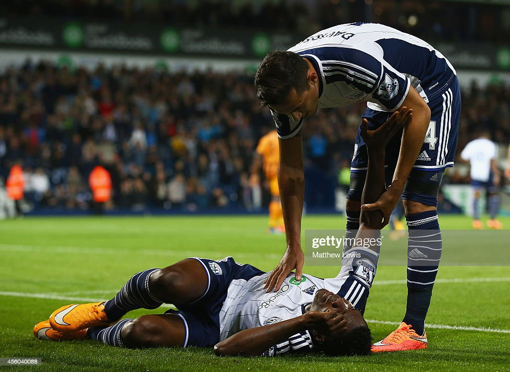 Brown Ideye of West Bromwich Albion is helped by Jason Davidson after getting injured after scoring his goal during the Capital One Cup Third Round match between West Bromwich Albion and Hull City at The Hawthorns on September 24, 2014 in West Bromwich, England.