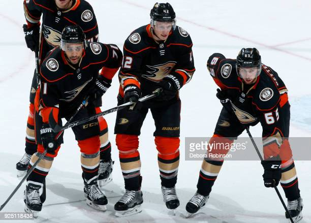T Brown Josh Manson and Marcus Pettersson of the Anaheim Ducks line up for a faceoff during the game against the Edmonton Oilers on February 25 2018...