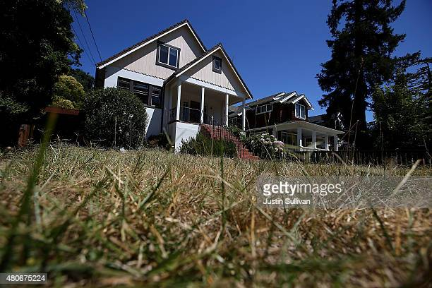 A brown lawn is seen in front of a home on July 14 2015 in San Anselmo California California Gov Jerry Brown has signed legislation to protect...