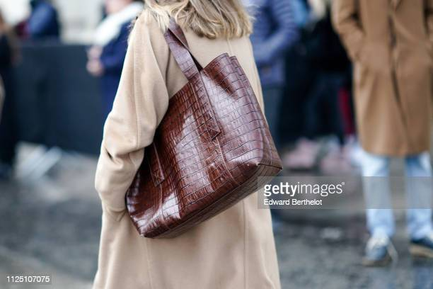 A brown leather bag outside Alexandre Vauthier during Paris Fashion Week Haute Couture Spring Summer 2020 on January 22 2019 in Paris France