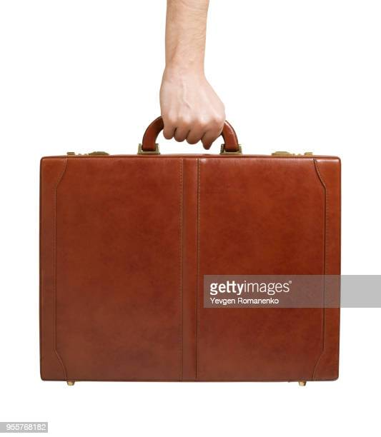 brown leather briefcase in hand - briefcase stock pictures, royalty-free photos & images