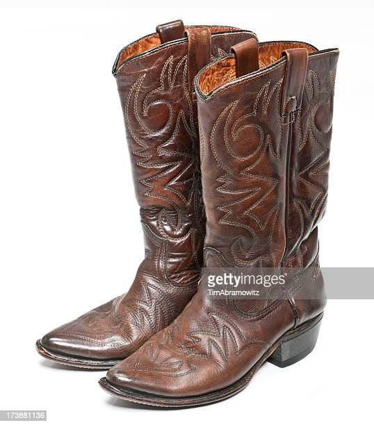 Brown leather cowboy boots with designs