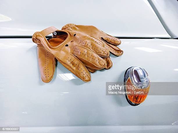 Brown Leather Gloves On White Car