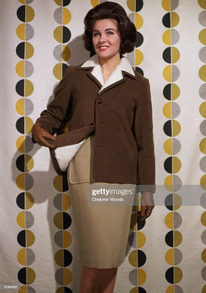 A brown leather light-weight sheepskin jacket worn over a slim beige skirt.