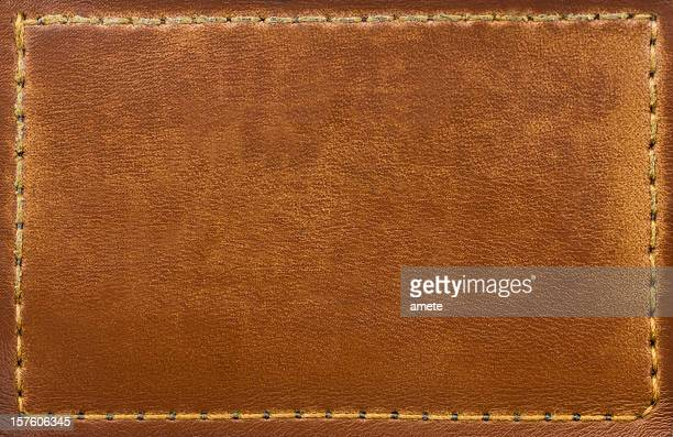 Brown leather patch with stitching along the edges