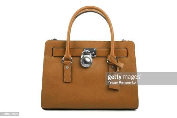 brown leather women's handbag on white background - objet quotidien photos et images de collection