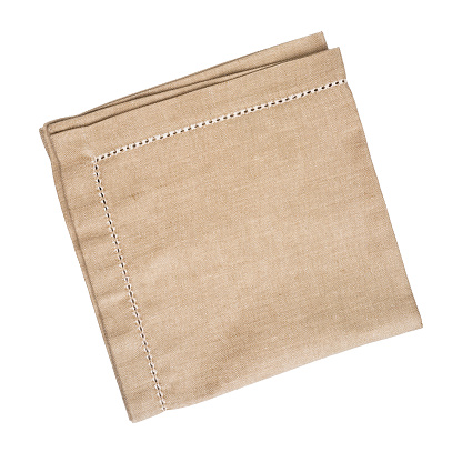 Brown linen napkin isolated on white background 525032618