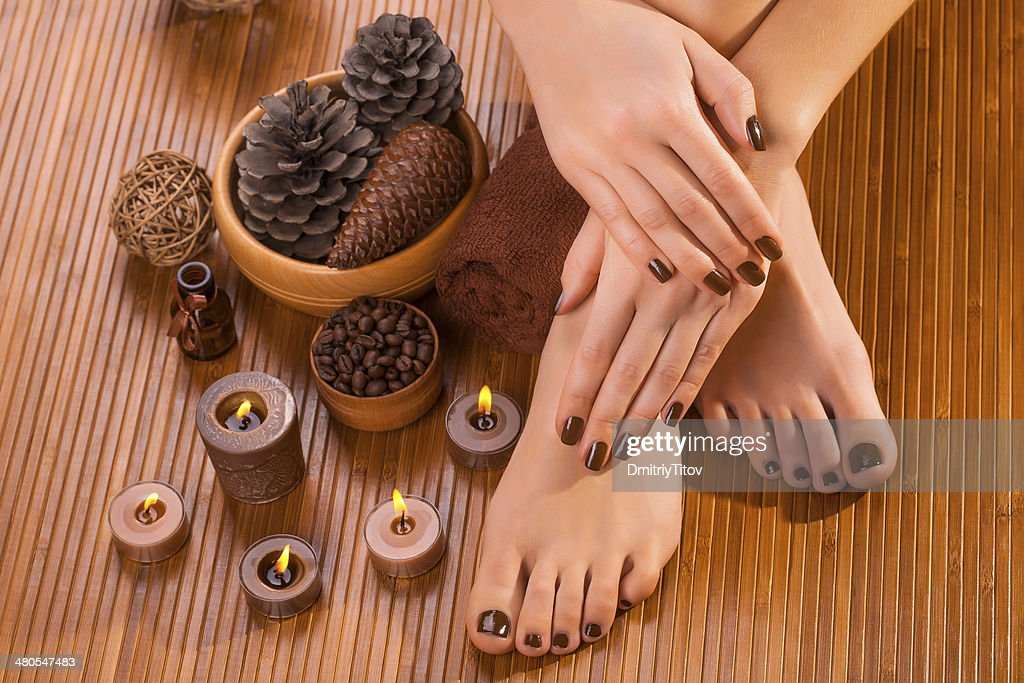 brown manicure and pedicure on the bamboo : Stock Photo