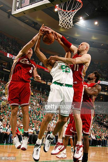 J Brown of the Boston Celtics has his shot blocked by Sasha Pavlovic and Zydrunas Ilgauskas of the Cleveland Cavaliers in Game Seven of the Eastern...
