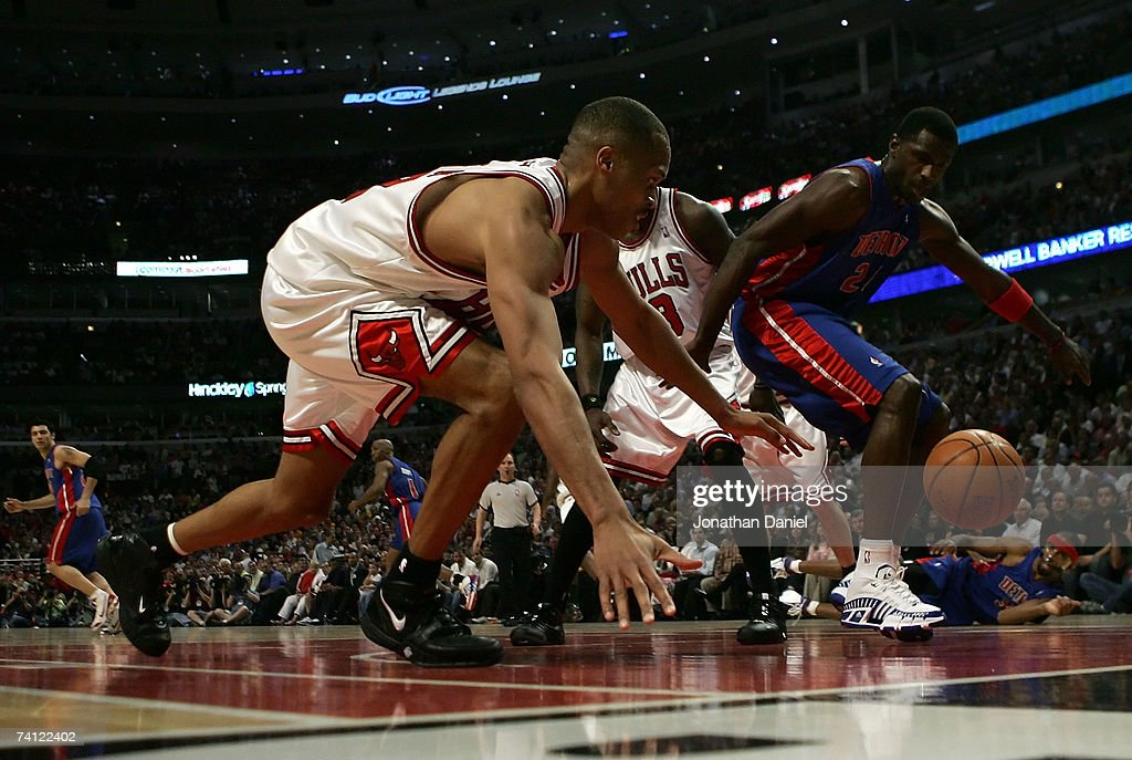 P.J. Brown #42 of the Chicago Bulls scrambles for a loose ball against Antonio McDyess #24 of the Detroit Pistons in Game Three of the Eastern Conference Semifinals during the 2007 NBA Playoffs at the United Center Center on May 10, 2007 in Chicago, Illinois.