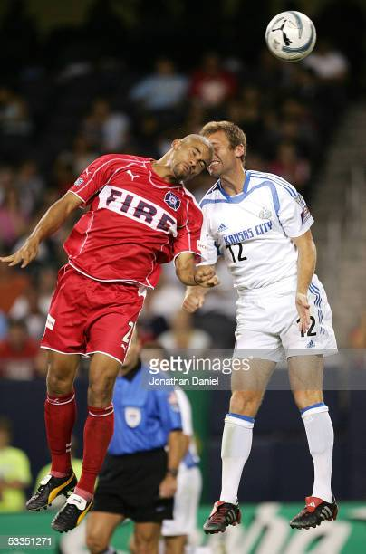 J Brown of the Chicago Fire and Jimmy Conrad of the Kansas City Wizards collide headtohead while battling for the ball on August 10 2005 at Soldier...