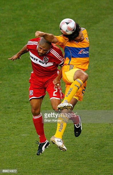 Brown of the Chicago Fire and Jose Francisco Fonseca of Tigres UANL go up for a header during the SuperLiga 2009 Final at Toyota Park on August 5,...