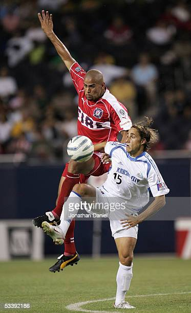 J Brown of the Chicago Fire and Josh Wolff of the Kansas City Wizards vie for the ball during their MLS match on August 10 2005 at Soldier Field in...