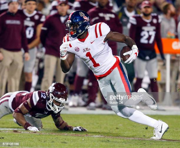 J Brown of the Mississippi Rebels catches a pass as JT Gray of the Mississippi State Bulldogs defends during the first half of an NCAA football game...