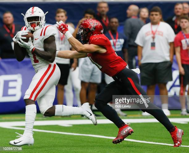 J Brown of the Mississippi Rebels catches a pass behid Justus Parker of the Texas Tech Red Raiders and runs in for a 34 yard score in the fourth...
