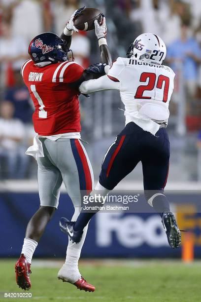 J Brown of the Mississippi Rebels catches the ball over Khalil McDonald of the South Alabama Jaguars during the second half of a game at...