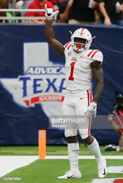 J Brown of the Mississippi Rebels celebrates after scoring on a 34 yard pass and run in the fourth quarter against the Texas Tech Red Raiders at NRG...