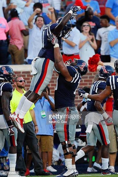 Brown of the Mississippi Rebels celebrates with Javon Patterson after scoring a touchdown against the Alabama Crimson Tide at Vaught-Hemingway...
