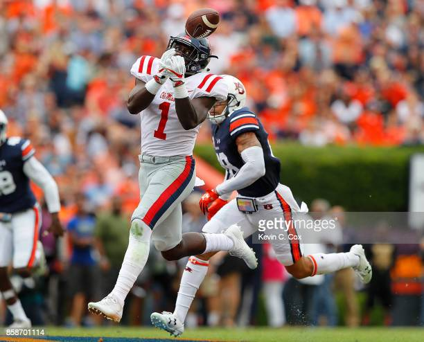 J Brown of the Mississippi Rebels fails to pull in this reception against Tray Matthews of the Auburn Tigers at Jordan Hare Stadium on October 7 2017...