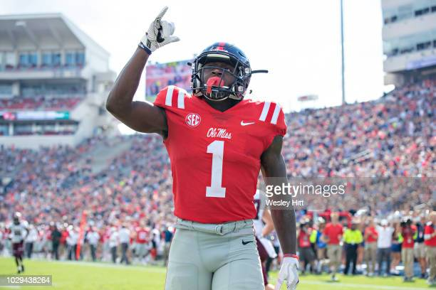 J Brown of the Mississippi Rebels points to the sky after scoring a touchdown against the Southern Illinois Salukis during the first half at...