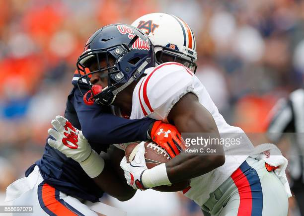 J Brown of the Mississippi Rebels pulls in this reception against Stephen Roberts of the Auburn Tigers at Jordan Hare Stadium on October 7 2017 in...