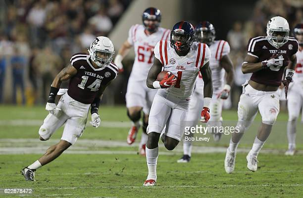 J Brown of the Mississippi Rebels rushes past Justin Evans of the Texas AM Aggies in the second quarter at Kyle Field on November 12 2016 in College...