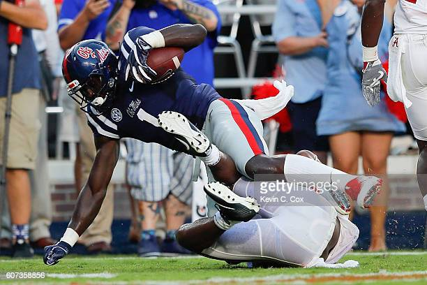 J Brown of the Mississippi Rebels scores a touchdown against the Alabama Crimson Tide at VaughtHemingway Stadium on September 17 2016 in Oxford...