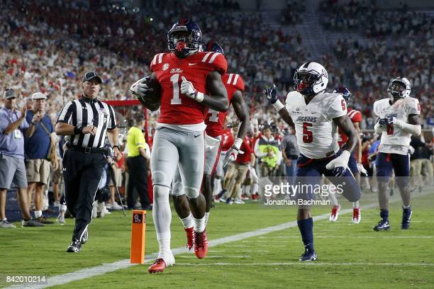 J Brown of the Mississippi Rebels scores a touchdown during the second half of a game against the South Alabama Jaguars at VaughtHemingway Stadium on...