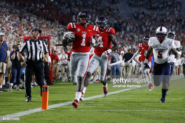 J Brown of the Mississippi Rebels scores a touchdown during the second half of a game against South Alabama Jaguars at VaughtHemingway Stadium on...
