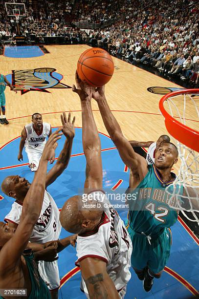 J Brown of the New Orleans Hornets fights for a rebound against Derrick Coleman of the Philadelphia 76ers November 5 2003 at the Wachovia Center in...