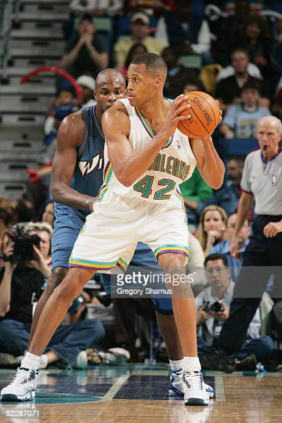 J Brown of the New Orleans Hornets is defended by Brendan Haywood of the Washington Wizards during the game at New Orleans Arena on February 14 2005...