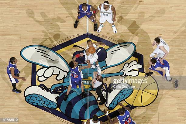 J Brown of the New Orleans Hornets jumps for the tipoff against Mikki Moore of the Los Angeles Clippers during the game at the New Orleans Arena on...