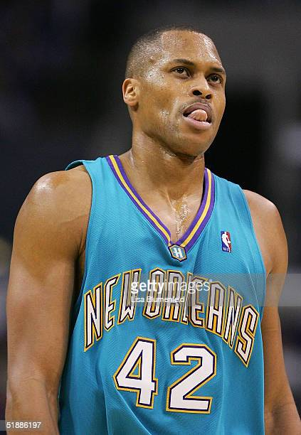 J Brown of the New Orleans Hornets looks up at the scoreboard in the first half against the Los Angeles Clippers on December 21 2004 at Staples...