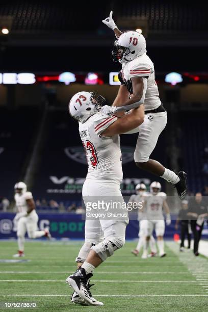 J Brown of the Northern Illinois Huskies celebrates a third quarter touchdown with Max Scharping while playing the Buffalo Bulls during the MAC...