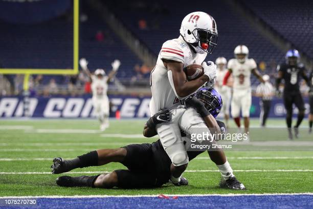 J Brown of the Northern Illinois Huskies scores the game winning touchdown past Cameron Lewis of the Buffalo Bulls during the MAC Championship at...