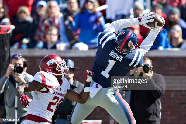 J Brown of the Ole Miss Rebels catches a pass over Josh Liddell of the Arkansas Razorbacks at Hemingway Stadium on October 28 2017 in Oxford...