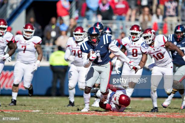 J Brown of the Ole Miss Rebels runs the ball during a game against the Arkansas Razorbacks at Hemingway Stadium on October 28 2017 in Oxford...