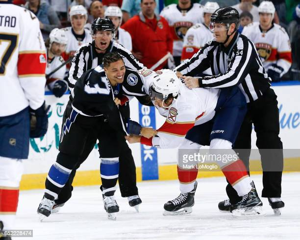 T Brown of the Tampa Bay Lightning fights against Alex Petrovic of the Florida Panthers during the first period at Amalie Arena on March 11 2017 in...