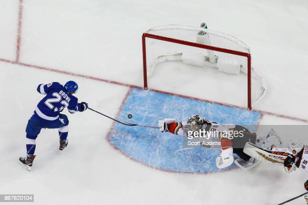 T Brown of the Tampa Bay Lightning has his shot saved by a diving goalie John Gibson of the Anaheim Ducks during the second period at Amalie Arena on...