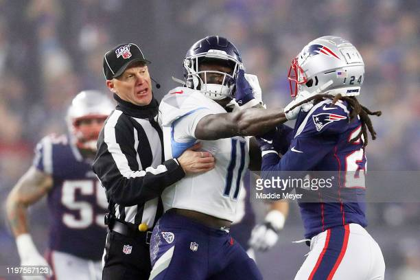 J Brown of the Tennessee Titans and Stephon Gilmore of the New England Patriots are separated by a referee as they get into an altercation in the...