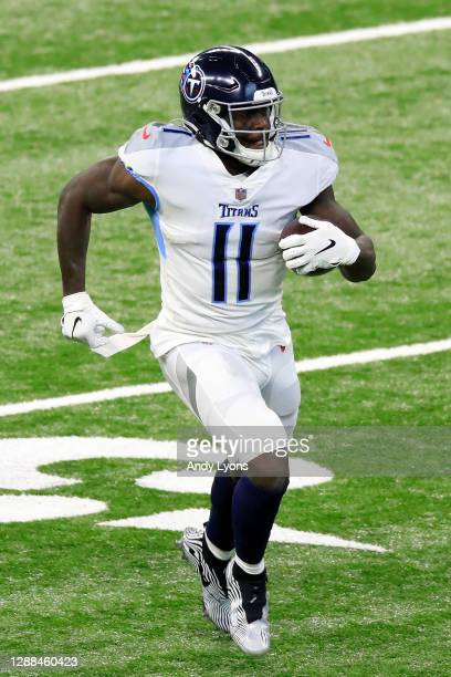 Brown of the Tennessee Titans carries the ball for a touchdown following a catch in the first quarter during their game against the Indianapolis...