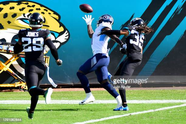Brown of the Tennessee Titans catches a touchdown pass in front of Sidney Jones of the Jacksonville Jaguars during the first quarter at TIAA Bank...