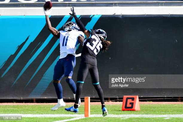 Brown of the Tennessee Titans catches a touchdown pass over Sidney Jones of the Jacksonville Jaguars in the first quarter at TIAA Bank Field on...