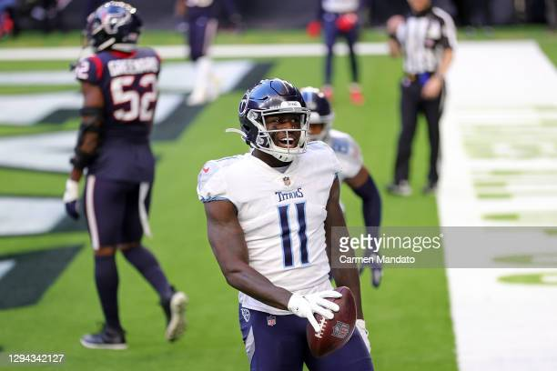 Brown of the Tennessee Titans celebrates a touchdown during the first half against the Houston Texans at NRG Stadium on January 03, 2021 in Houston,...